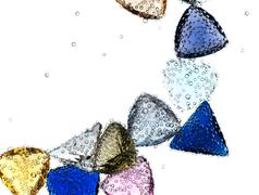 Gems falling in pure water against white. Stock Illustration