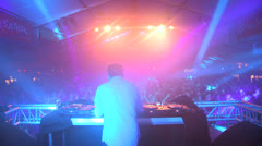 Overshoulder of a DJ playing at a festival Stock Footage
