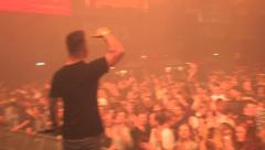 Overshoulder of a MC playing at a festival Stock Footage