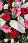 anthurium, roses and gerberas in a bridal arrangement - stock photo