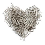 Stationery love concept. heart shaped staples background. Stock Photos