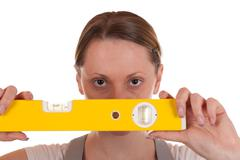 young carpenter holding a spirit level - stock photo
