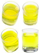 glass of yellow carbonated water with vitamin - stock photo