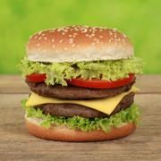 double cheeseburger with tomatoes and lettuce - stock photo