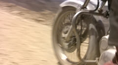 Royal Enfield, road and dust Stock Footage