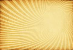 sunburst retro texture on old paper. - stock photo