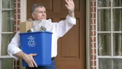 Green concept man taking recycling out of house Stock Footage