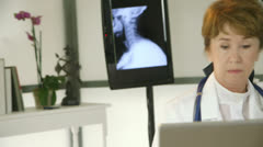 Tilt to woman doctor using a microscope Stock Footage