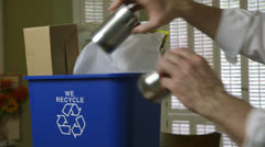 Man picks up recycle bin Stock Footage
