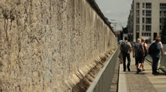 Tourists visiting Berlin wall Stock Footage