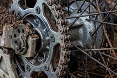 enduro motorbike wheel and chain. closeup shot - stock photo
