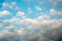 Clouds sky sunset background, horizontal orient. Stock Photos