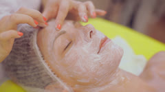 Beautiful girl lies in the beauty salon. She enjoys the process of Stock Footage