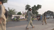 Stock Video Footage of Pakistani Men Walking in front of a Mosque