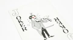 Joker on table Stock Footage