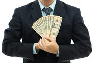 Stock Photo of businessman holding money