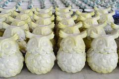 variety of owl ceramic pots - stock photo