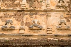 Ancient buddha statue on old pagoda in the ancient buddhist temple Stock Photos