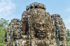 faces of bayon tample. ankor wat. cambodia. - stock photo