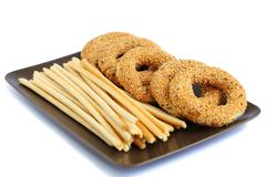 round rusks and bread sticks - stock photo