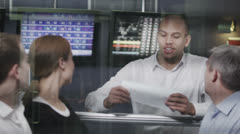 Casual team of financial traders taking a look at the figures - stock footage