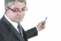 Businessman indicating Stock Photos