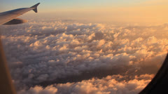 Clouds and sky as seen through window of an aircraft at sunrise. Stock Footage