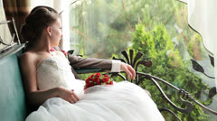 Wedding couple looking at the rain Stock Footage