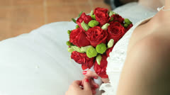 Bride holding red bouquet - stock footage