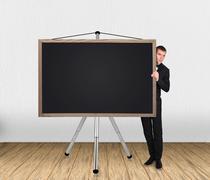 Businessma and blank blackboard Stock Photos
