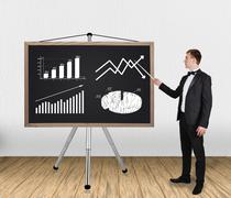 businessman pointing on chart - stock photo