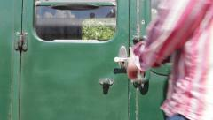 British Railway: Passenger getting onto train Stock Footage