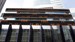 Stock Market Shares Display NYC Times Square LED Ticker Board Dow Jones Nasdaq - stock footage