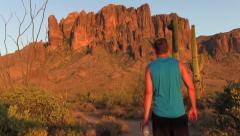 Man walking towards mountain. - stock footage