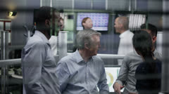 Casual team of financial traders take a break from work to chat together Stock Footage