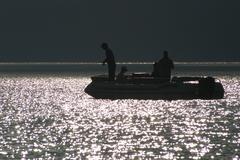 Fishing Boat Silhouette - stock photo