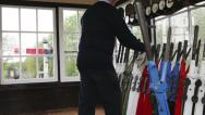 Stock Video Footage of British Railway: Signalman pushing lever into place in signal box