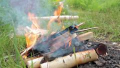 Man throwing firewoods in bonfire (making a bonfire) Stock Footage