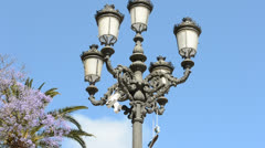 Sneakers hang on a lamp. City of Cadiz, Spain, Andalusia. Stock Footage