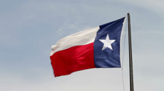 Texas flag blowing in the wind Stock Footage
