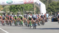 BIKE RACERS UNDER FINISH LINE SLOW-MOTION Stock Footage