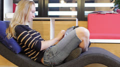 Young Girl Using Tab at School Library - stock footage