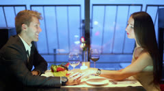 Lady touches hand of blond man during talk in restaurant - stock footage