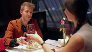 Stock Video Footage of Couple clink glasses and drink red wine during sit in restaurant