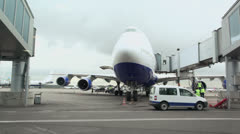 Passengers aircraft is on embarkation near terminal at airport Stock Footage