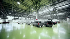 Just made automobiles stand in huge hangar of factory - stock footage