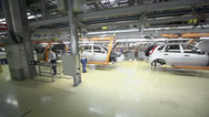 Stock Video Footage of Workers assemble cars on conveyor at Avtovaz factory