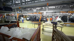 Workers assemble cars on conveyer of Avtovaz factory Stock Footage