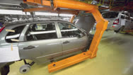 Stock Video Footage of Body of passenger cars at conveyer in Avtovaz factory