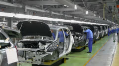 Workers assemble cars Lada Kalina on conveyer of factory VAZ - stock footage